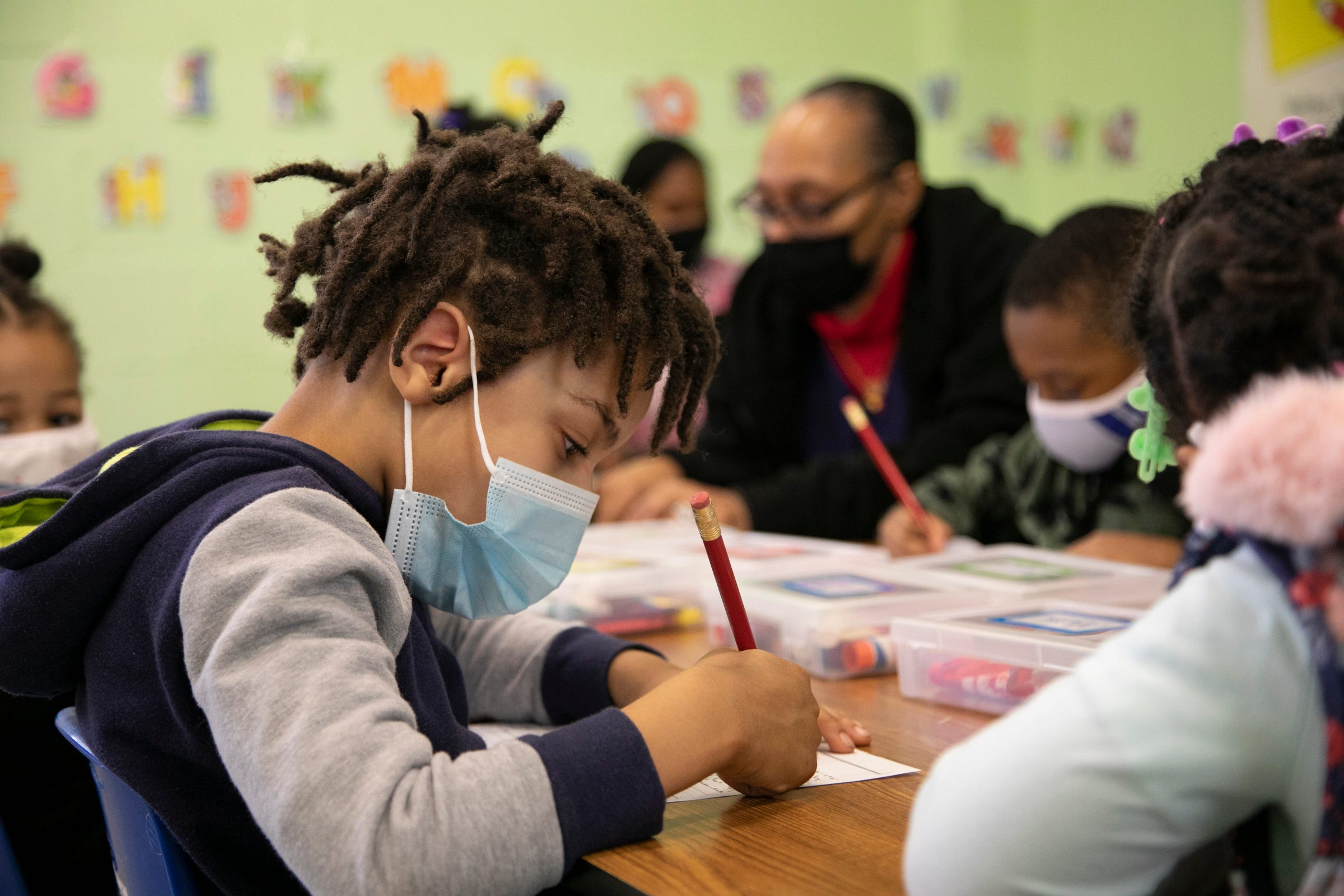 Corey Jones, 4, of Detroit, focuses on writing his name during class at the Franklin Wright Settlements that turns 140 this year. The organization is all about helping Detroiters with basic life, social, and family needs. We visit the early education arm of the organization in Detroit on Mar. 11, 2021.