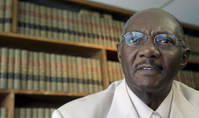 Elbert Hatchett, talks about the Pontiac school district lawsuit in his Pontiac law office in 2004. Hatchett won the suit that forced the district to integrate. The case led to death threats against him, shots fired through his office window and forced him to hire full-time bodyguards for himself and his family.