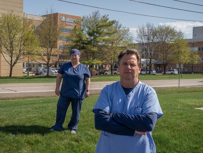 McLaren Macomb nurses Jeff Morawski (right) and Terri Dagg-Barr stand outside of McLaren Macomb Hospital in Mt. Clemens on Friday, April 9, 2021.