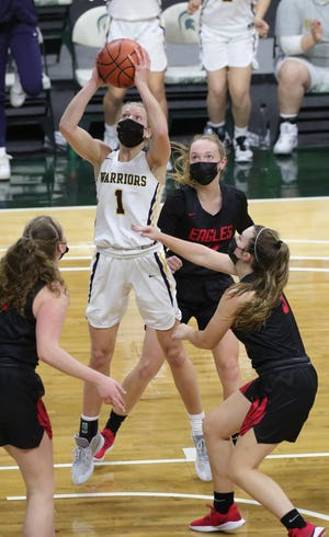 Grass Lake's Lexus Bargesser shoots against Kent City during the 52-50 win over Kent City in the Division 3 girls basketball state title game on Friday, April 9, 2021, at the Breslin Center in East Lansing.