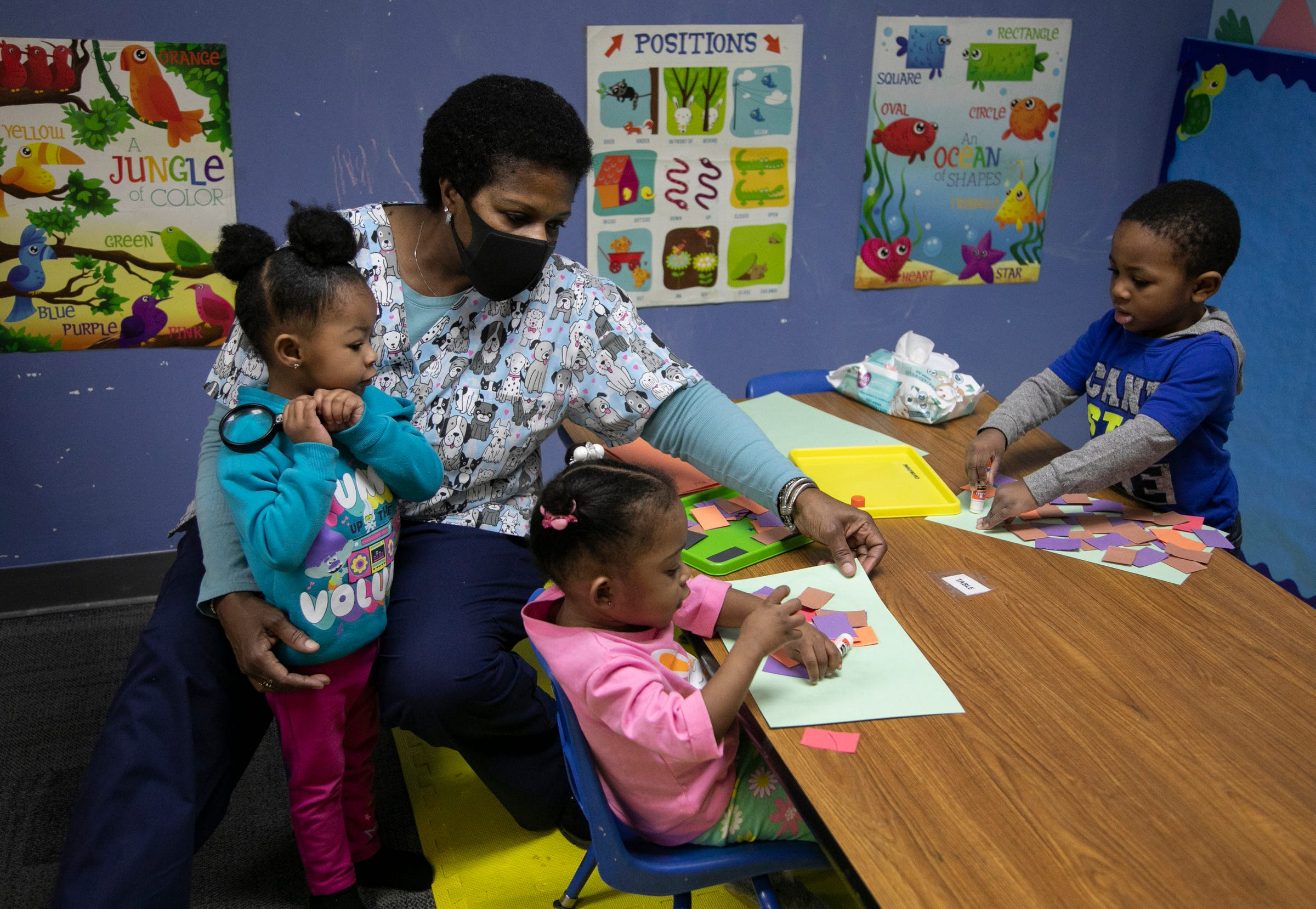 Early start teacher Theresa Copeland wraps up an art project with her students Brailey Hutchinson, 2, left, Aliah Hicks, 2, and Apollo Burton, 2, on Mar. 11, 2021. Franklin Wright Settlements turns 140 this year. The organization is all about helping Detroiters with basic life, social and family needs.