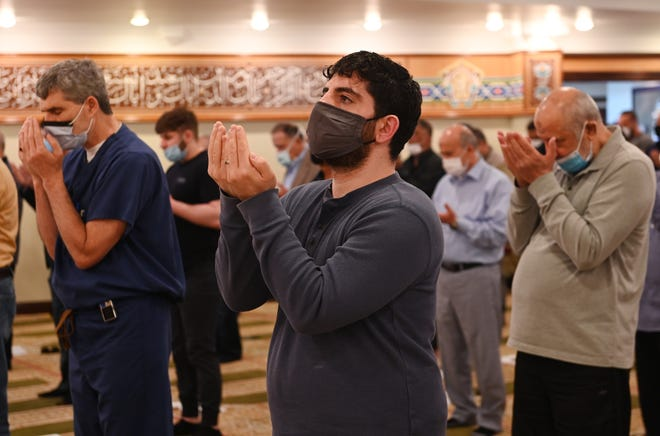 Ibraham Assi, 35, of Dearborn Heights prays during the Friday service ahead of the holy month of Ramadan.