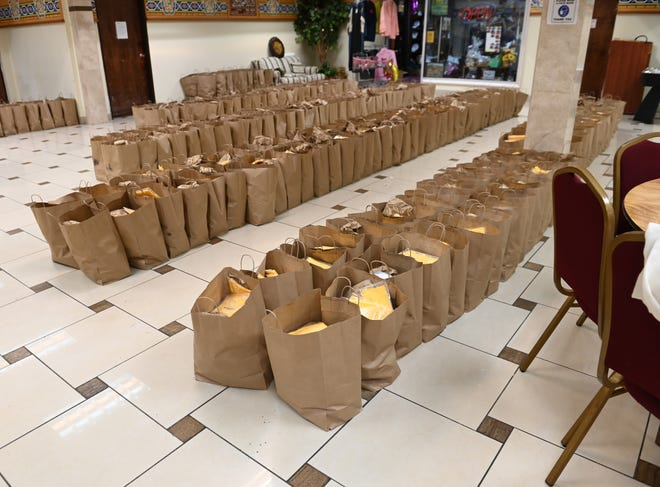 Bags of food are ready to be distributed to mosque members for Ramadan.