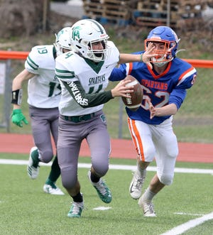Spackenkill quarterback Anthony Hoyt rolls out as Thomas A. Edison's Angelo Steinhauer pursues him during Spackenkill's 66-0 win in eight-man football on April 9 in Elmira Heights.