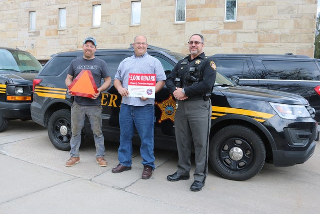 Sheldon Miller and Dean Schiller, of the Ottawa County Farm Bureau, and Ottawa County Sheriff Steve Levorchick are raising awareness of farm crime and farm safety with planting season underway.