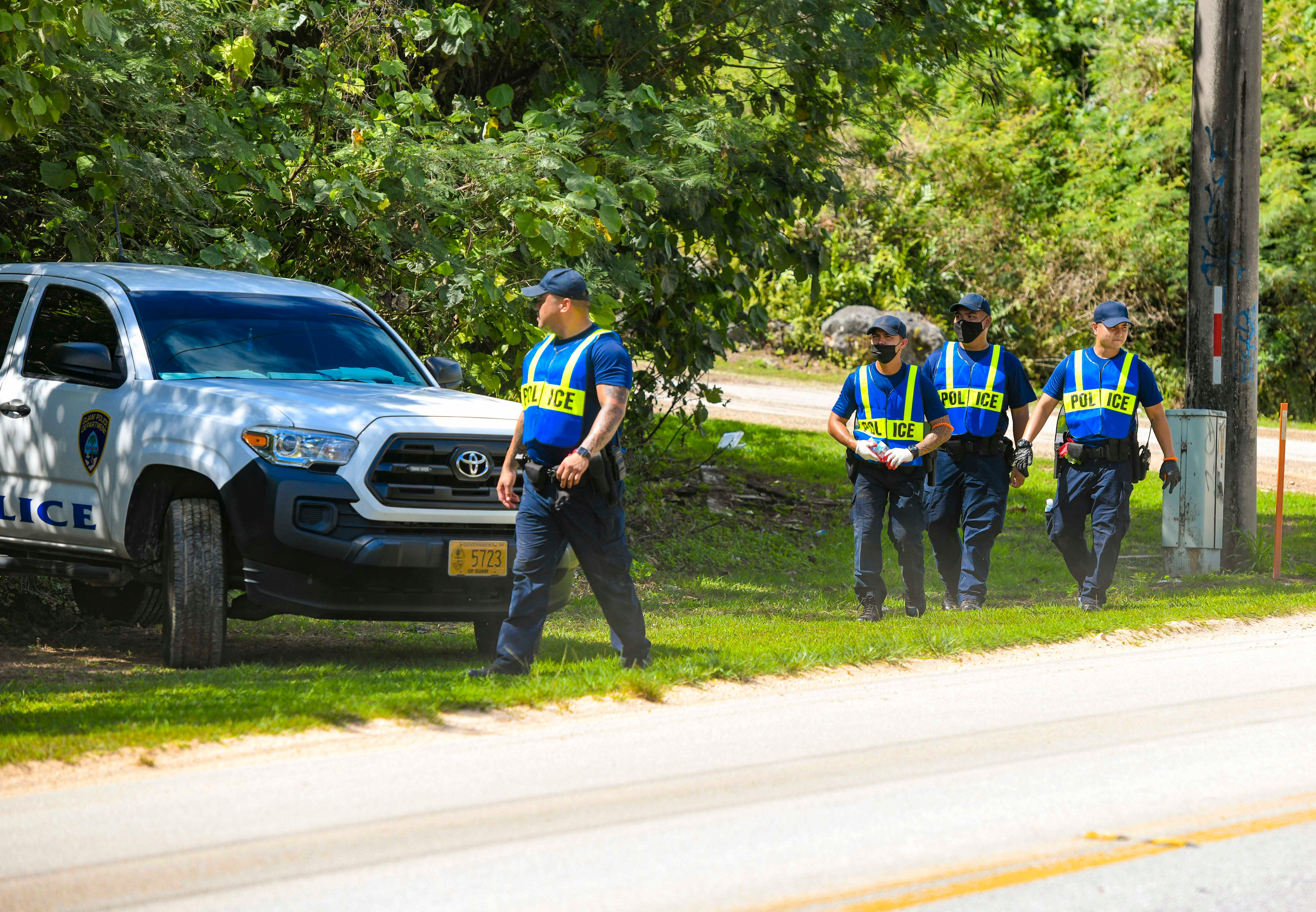 A group of police officer trainees call out to Fernando Canlas as they search for the man, along Route 15 in Yigo, on Friday, April 9, 2021. A search for Canlas was initiated by family members, emergency responders, friends and rescue volunteers the day before, after he was reported missing.