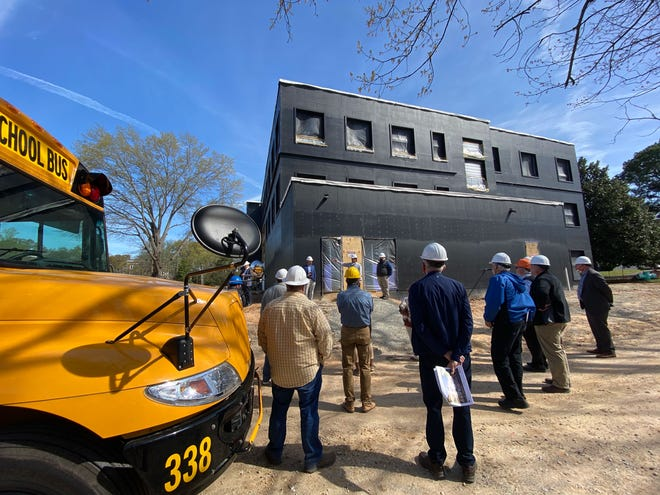 Jackson-Madison County School System board members, city officials and central office leadership toured the Madison Academic construction site on March 30, 2021.