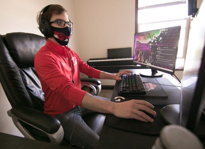 Jarod Ericksen, esports coach at Cleary University, plays League of Legends in his Tyrone Township home Friday, April 9, 2021.