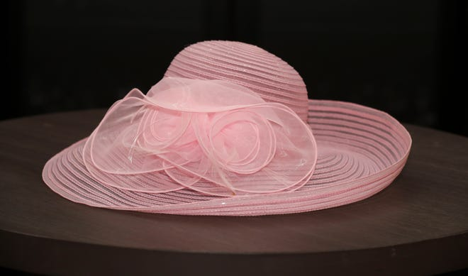 A perfect color for a trip to Churchill Downs on Kentucky Oaks Day, this pink wide brim hat with rose embellishment, $42, will make you feel like a million dollars, even if you're not sitting on Millionaire's Row. Big Brims and Fancy Trims Annual Sample Hat Sale at the Kentucky Derby Museum in Louisville.