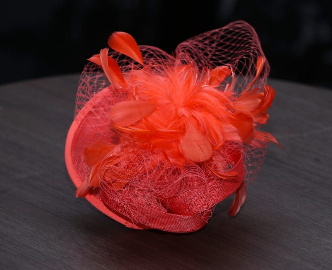 This coral fascinator with feathers and netting, $40, is a perfect pick for a long day in the infield or in a reserved seat at the First turn or elsewhere at the track. We love the idea of pairing this eye-popping color with a navy dress and nude heels. Big Brims & Fancy Trims annual Derby Hat sample sale at the Kentucky Derby Museum in Louisville, Ky. on Apr. 8, 2021.
