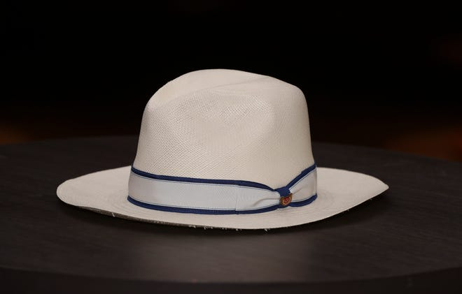This classic white fedora, with a blue ribbon and horseshoe decal, $75, will turn any man into one of the most stylish at the track. Big Brims & Fancy Trims annual Derby Hat sample sale at the Kentucky Derby Museum in Louisville, Ky. on Apr. 8, 2021.
