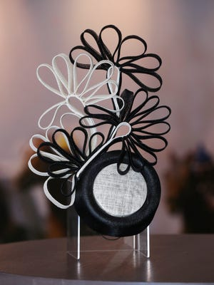 This black and white structured fascinator, $70, is just as much art as it is fashion. Anyone bold enough to sport this look will certainly turn heads, whether they're attending the Kentucky Derby or a Royal Wedding. Big Brims & Fancy Trims annual Derby Hat sample sale at the Kentucky Derby Museum in Louisville, Ky. on Apr. 8, 2021.