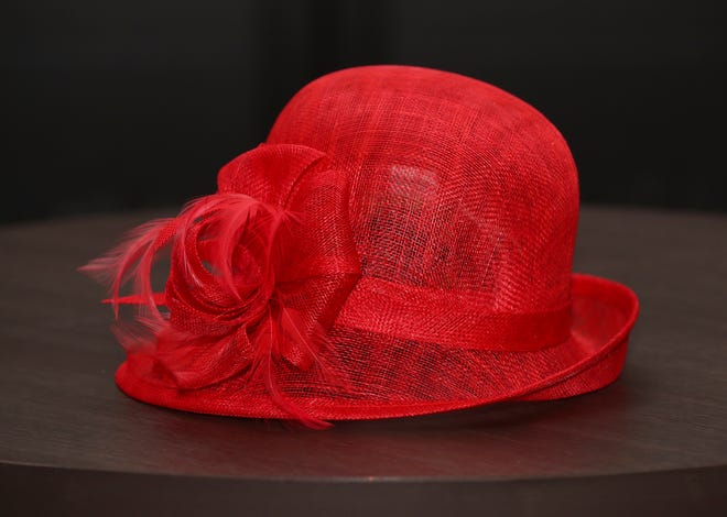 Nothing says Run for the Roses quite like the color red. This red bucket hat decked out with feathers and a bow, $32, will top any bold Derby Day ensemble. Big Brims & Fancy Trims annual Derby Hat sample sale at the Kentucky Derby Museum in Louisville, Ky. on Apr. 8, 2021.