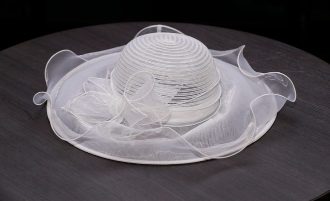 Looking for something southern yet demur? Then this classic wide-brim white hat with a bow, $42, might be the best bet you'll make on Kentucky Derby Day. Big Brims & Fancy Trims annual Derby Hat sample sale at the Kentucky Derby Museum in Louisville, Ky. on Apr. 8, 2021.