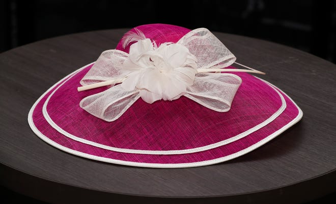This magenta and white hatinator, $72, with a white bow and flower accents is a classy yet fun way to embrace the stylish trend of dressing fabulously for the track. Big Brims & Fancy Trims annual Derby Hat sample sale at the Kentucky Derby Museum in Louisville, Ky. on Apr. 8, 2021.
