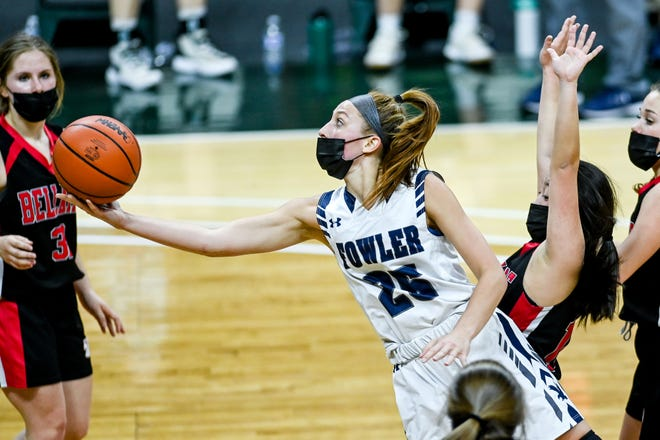 Fowler's Mia Riley, left, scores past Bellaire's Noel Mann, right, during the third quarter on Friday, April 9, 2021, at the Breslin Center in East Lansing.