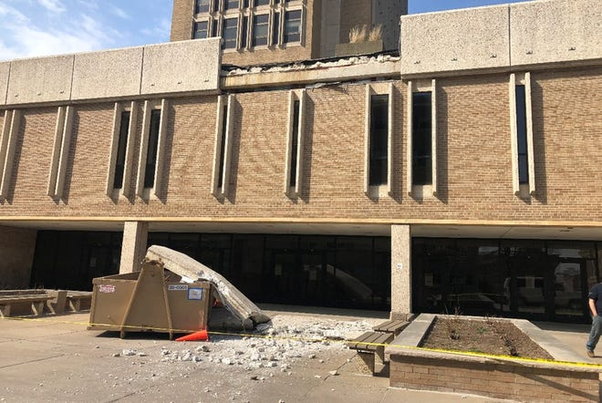 Two concrete slabs fell from the third floor of Van Hise Hall on UW-Madison's campus Sunday.