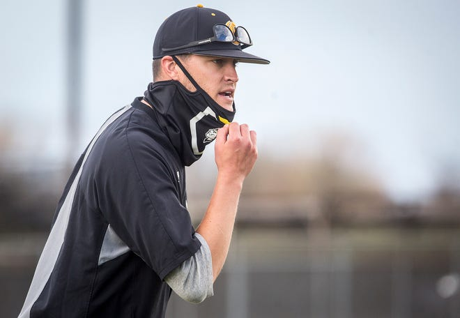 Cowan baseball coach Aaron Wells talks to hit team during a game against Daleville at Cowan High School Thursday, April, 8, 2021.