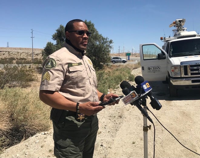 Riverside County sheriff's Sgt. Lionel Murphy updates members of the press on the shooting involving a sheriff's deputy just past Whitewater Canyon on Interstate 10 on April 9.