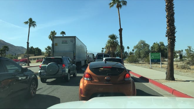 Cars were in gridlock on Palm Canyon Drive in Palm Springs hours after a deputy-involved shooting on Interstate 10, April 9, 2021.