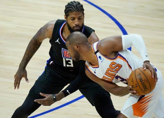 Apr 8, 2021; Los Angeles, California, USA; LA Clippers guard Paul George (13) defends Phoenix Suns guard Chris Paul (3) during the first quarter at Staples Center. Mandatory Credit: Robert Hanashiro-USA TODAY Sports