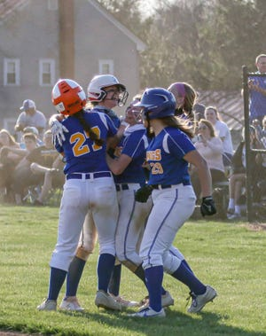 Northern Lebanon's Brooke Beamesderfer is mobbed by teammates after her walk-off hit gave NL a 5-4 come-from-behind win over Elco on Thursday.
