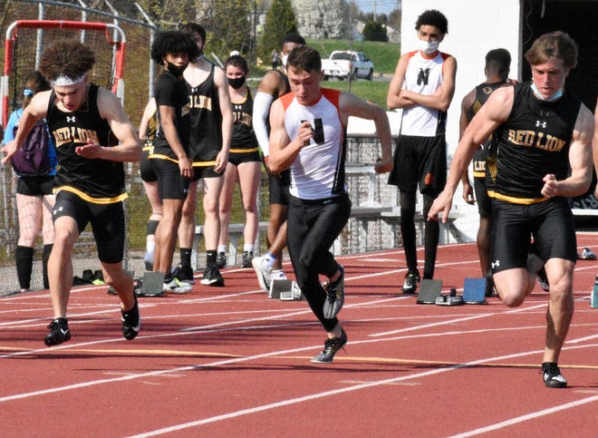 Red Lion senior Randy Fizer, right, sprints for a victory in the 100-meter dash on Thursday. Red Lion freshman LaDainian Strausbaugh, left, finished second in the event.