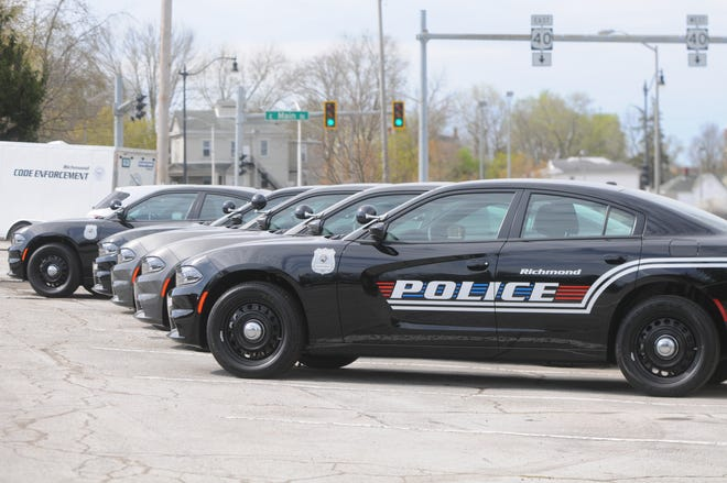Some of Richmond Police Department's new Dodge Chargers sit in the parking lot of the Richmond Municipal Building.