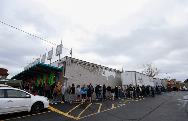 A line wraps around the parking of National Art Shop on Thursday, April 8, 2021 during a closing sale. The owners are retiring after more than 50 years in business.