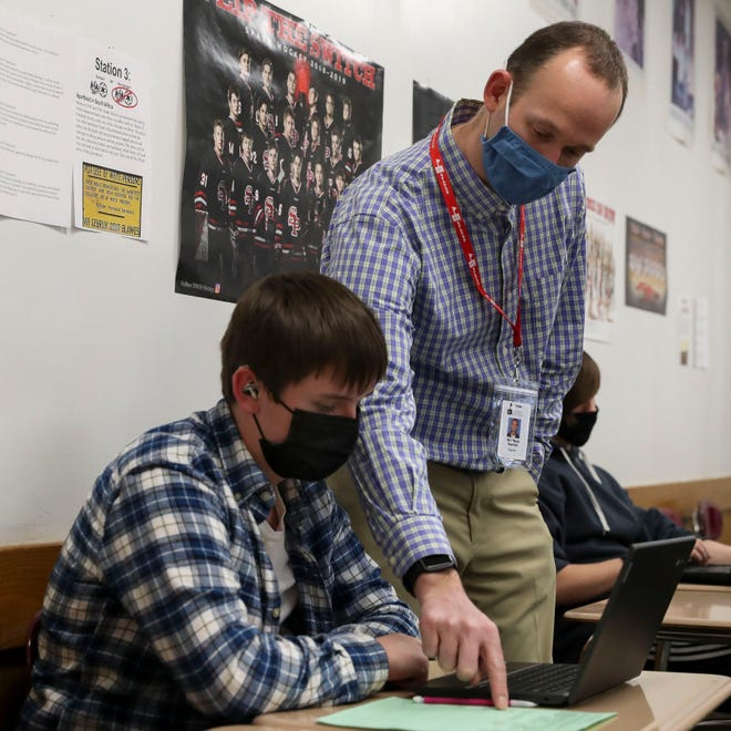 SPASH teacher Matt Ramlet helps Evan Williams with a question about an exercise on Thursday, February 25, 2021, at SPASH in Stevens Point, Wis. As students have returned to school during a pandemic, Ramlet says he tries to be a rock for the people around him, especially his students.Tork Mason/USA TODAY NETWORK-Wisconsin