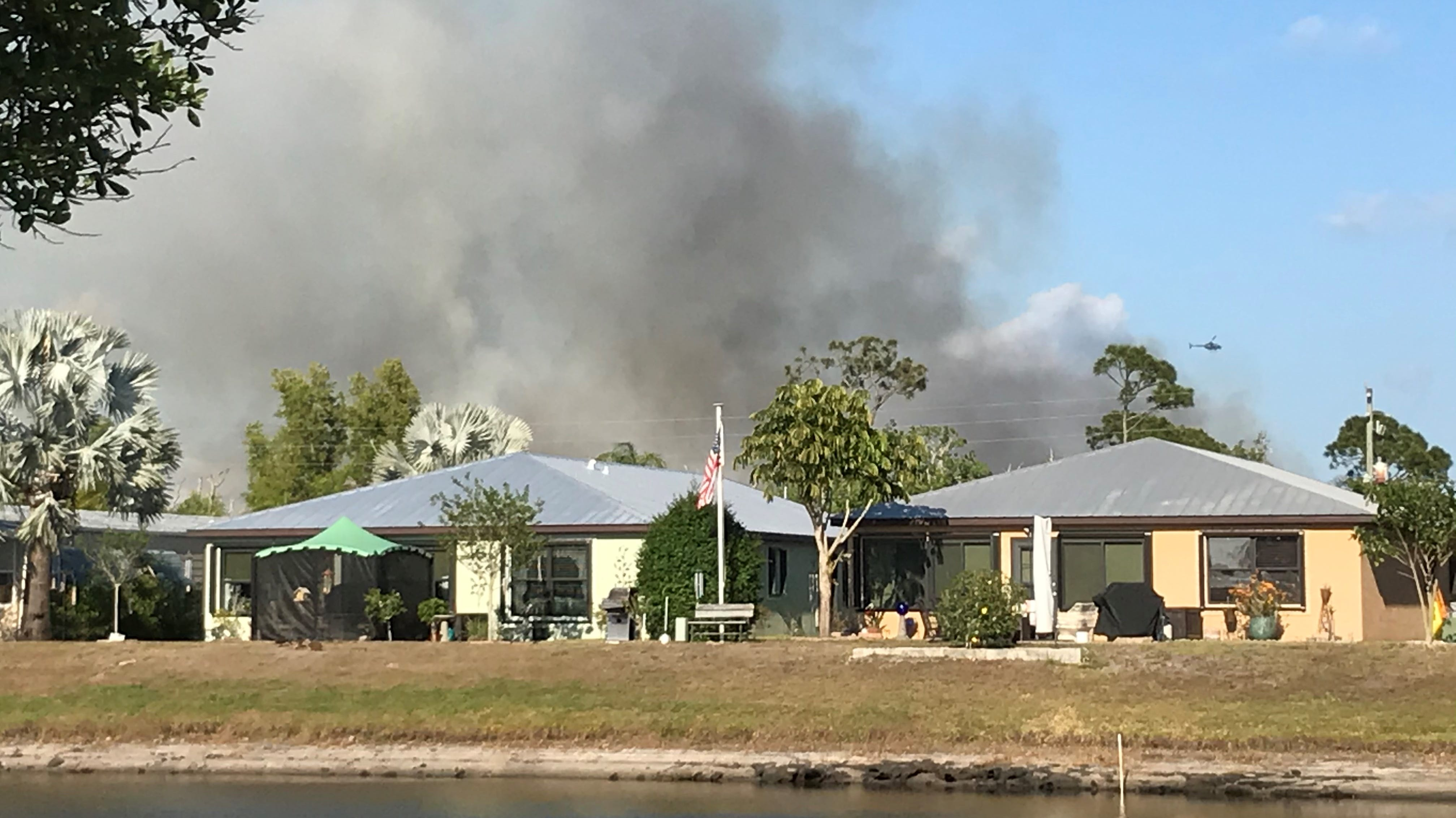 Fire agencies work to contain wildfire at Indian River-St. Lucie border