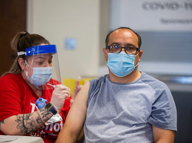 A member of the community gets a COVID-19 vaccine at Holy Spirit Church in the city of Horizon, Texas  on April 9, 2021.