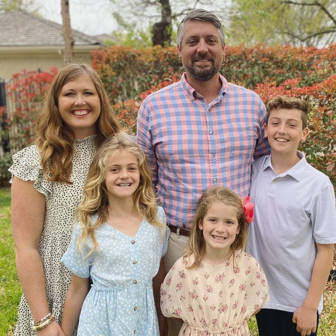 Parents Meagan and Ben Hoover are ardent supporters of the athletics and recreational bond proposition coming before voters May 1. They anticipate their children, 8-year-old Blair,  bottom left, 6-year-old Arden, bottom middle and 10-year-old Grant will likely attend the new east high school.