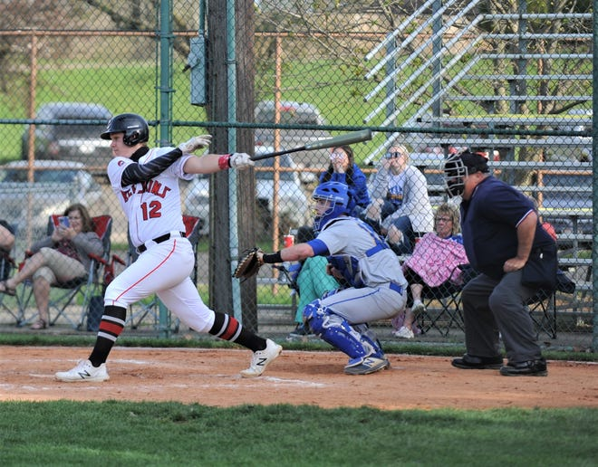 Coshocton's Brody Hammersley hits the ball during a game with Maysville. He set the school record for batting average in a season at .493 and will play baseball and soccer for Division III Bluffton University.