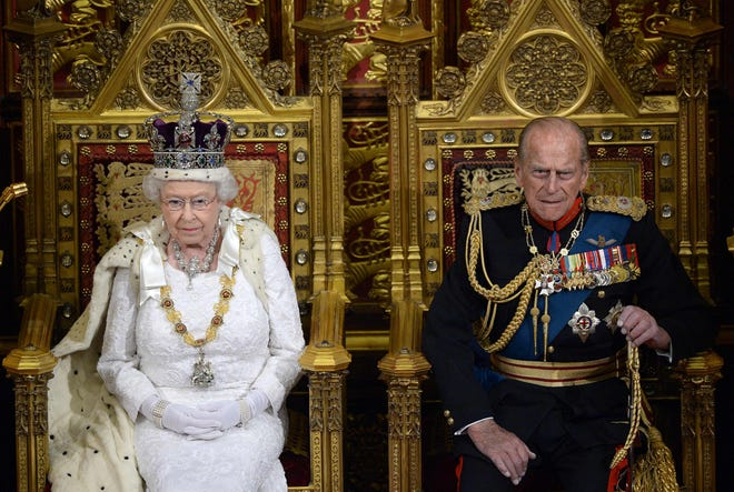Queen Elizabeth II seated on the Throne in the House of Lords next to Prince Philip, Duke of Edinburg as she prepares to deliver the Queen's Speech during the State Opening of Parliament at the Palace of Westminster on June 4, 2014.