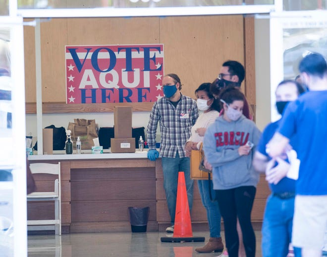 Travis County voters are shown lining up for Election Day last November. Prop H would provide publicly funded $25 vouchers that Austin voters could donate to the mayoral or City Council candidate of their choice.