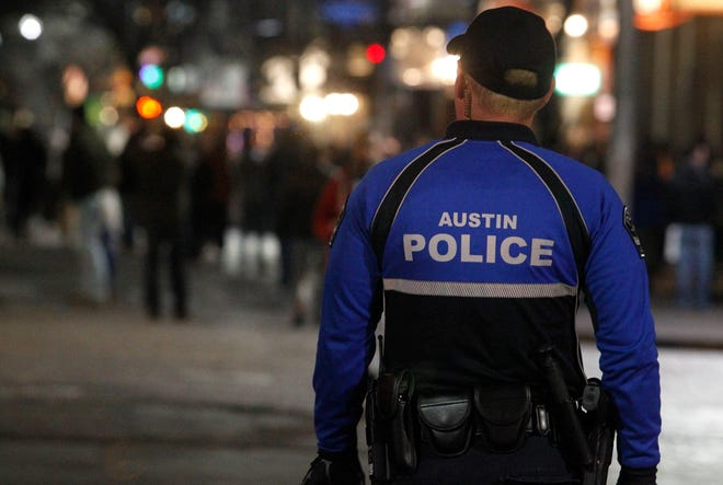 An Austin police officer is shown patrolling Sixth Street in downtown Austin.
