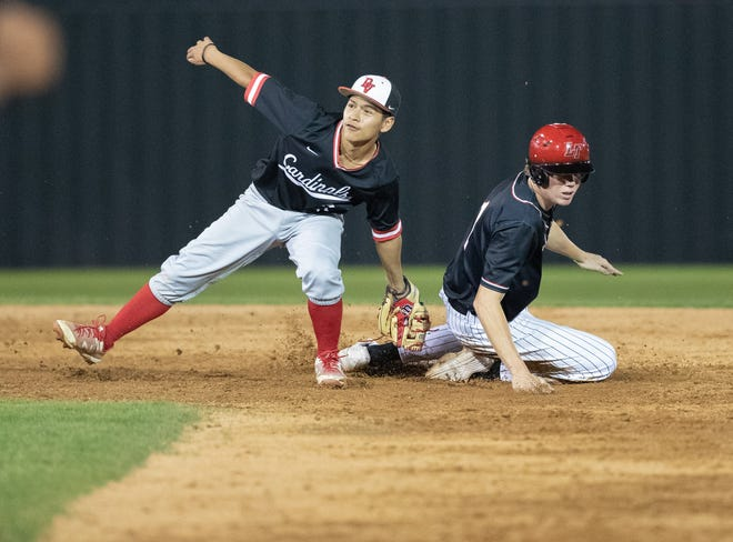 Del Valle infielder Roberto Velasquez makes a behind-the-back tag at second base during the 10-3 win over Del Valle Friday at Lake Travis High School.