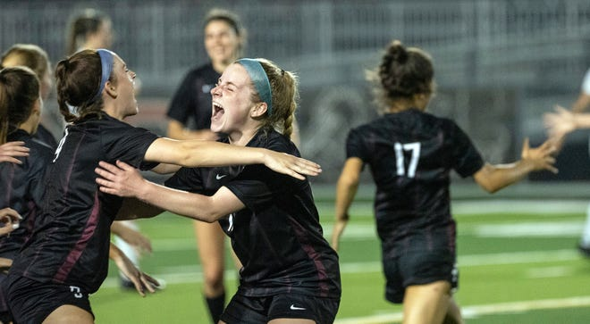 Dripping Springs' Avery Davis, right, jumps into the arms of Gracie Green as they celebrate the team's 2-0 victory over Cedar Park in the Class 5A Region IV championship match Friday.