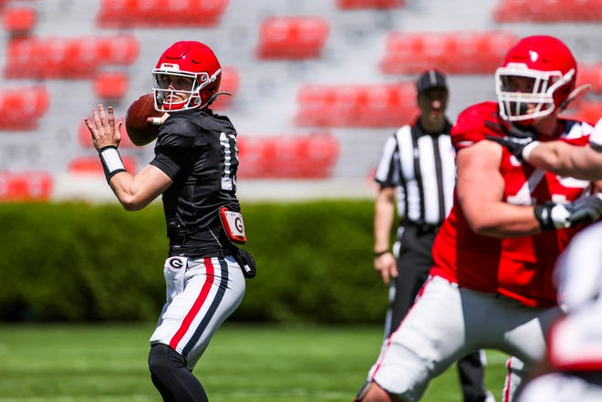 Georgia quarterback Carson Beck (15) during the Bulldogs' practice session on Dooley Field at Sanford Stadium in Athens, Ga., on Saturday, April 3, 2021. (Photo by Tony Walsh)