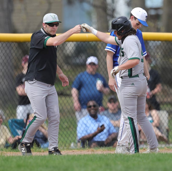 Nordonia head coach Drew Hoisington fits bumps Caden Gopalakrishna after his 5th inning triple against Trinity on Saturday, April 10, 2021 in Garfield Heights, Ohio, at Danko Field.   [Phil Masturzo/ Beacon Journal]
