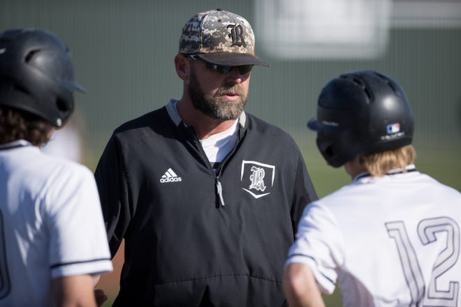 Randall coach Cory Hamilton talks to his players during a District 3-5A home game, Friday, April 9, 2021, against Amarillo High.