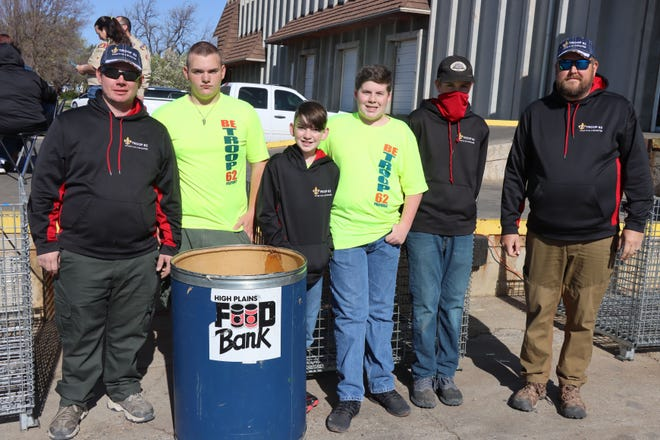 """Boy Scouts Troop 62 works at the High Plains Food Bank Saturday morning with the """"Scout for Food"""" drive."""