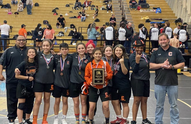 The Caprock girls wrestling team poses together after claiming the District 3-5A team title on Saturday afternoon at Amarillo High. [Shawn Moran]
