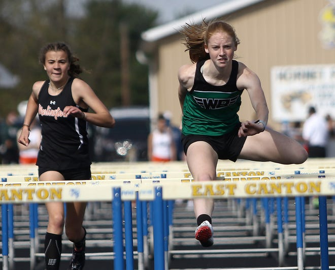 West Branch's Alexis Gregory, right, was the winner of this 100-meter hurdle heat which included Marlington's Elizabeth Mason, left, at the East Canton Track and Field Invitational Saturday, April 10, 2021.