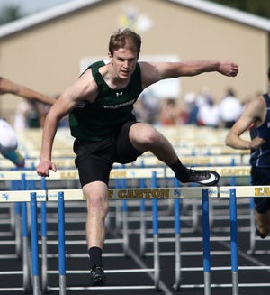 West Branch's Andrew Coffee clears the last hurdle in the lead during his 110-meter hurdle heat at the East Canton Invitational.
