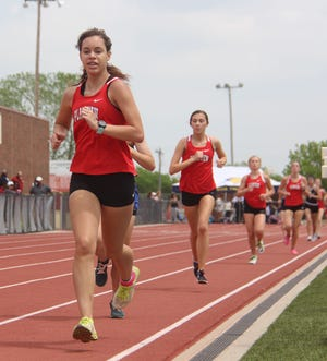 Plainview's Katie Wiggs, left, runs the 1,600 meter run with teammate Jacey Keith close behind. Wiggs took second, while Keith was fourth.