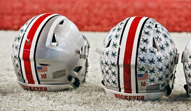 The helmets of Ohio State football players, as seen before the Big Ten championship game in 2017. [Barbara J. Perenic/Dispatch]