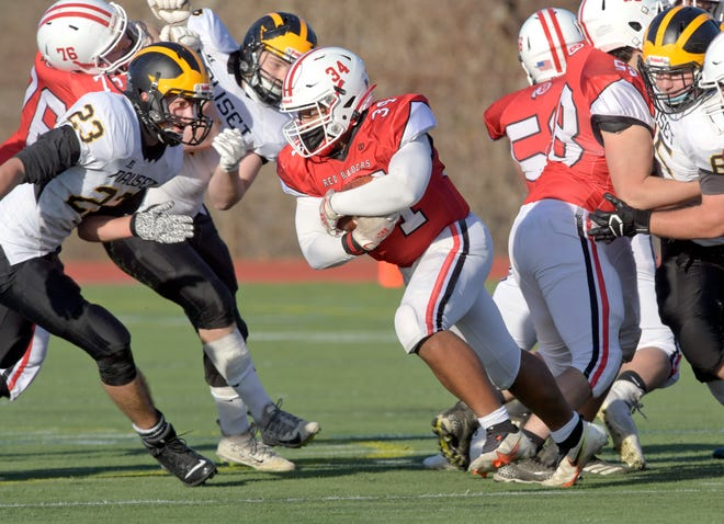 Eugene Jordan of Barnstable attempts to get past Dylan Joy (23) and other Nauset players in the first half of Friday's game at W. Leo Shields Field in Hyannis.