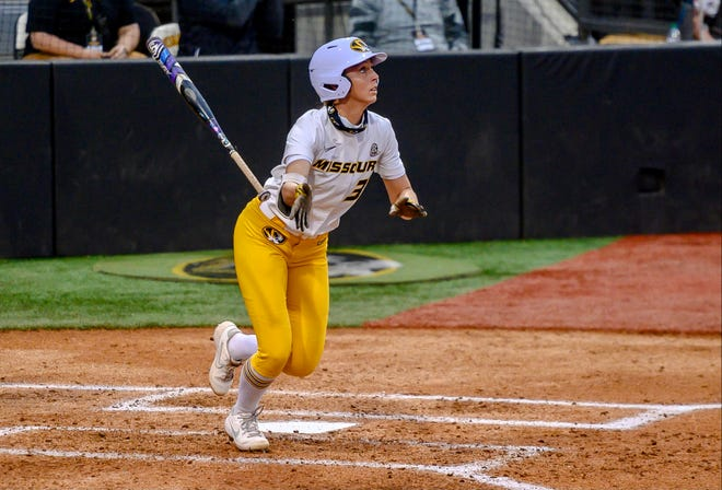 Missouri's Cayla Kessinger (33) follows the ball for a two-run home run during a game against LSU on April 9 at Mizzou Softball Stadium.